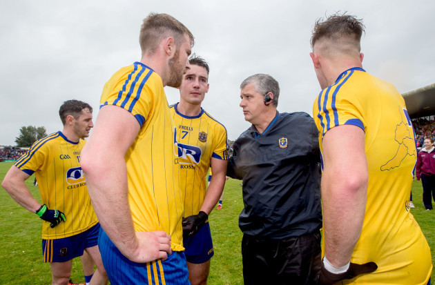 Thomas Corcoran, John McManus and Sean Mullooly speak with joint manager Kevin McStay after the game