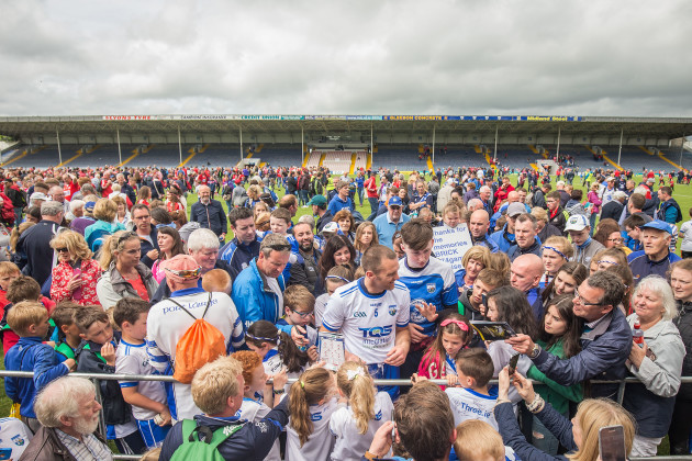 Michael Walsh with fans after the game