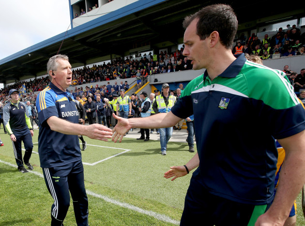Donal Moloney and Paul Kinnerk shake hands after the match