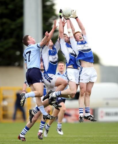 Brian Glynn of Laois claims midfield ball