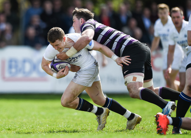 Gerry Hurley is tackled by Alex Thompson