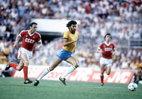1982 World Cup Finals. Seville, Spain. 14th June, 1982. Brazil 2 v USSR 1. Brazil's Socrates out-runs USSR's Tengiz Sulakvelidze for the ball.