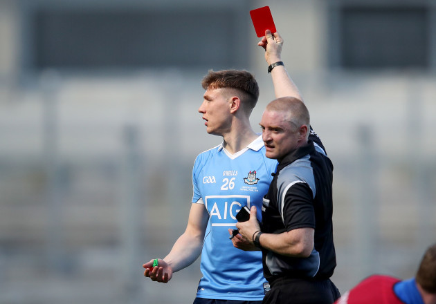 Barry Cassidy shows John Small a red card