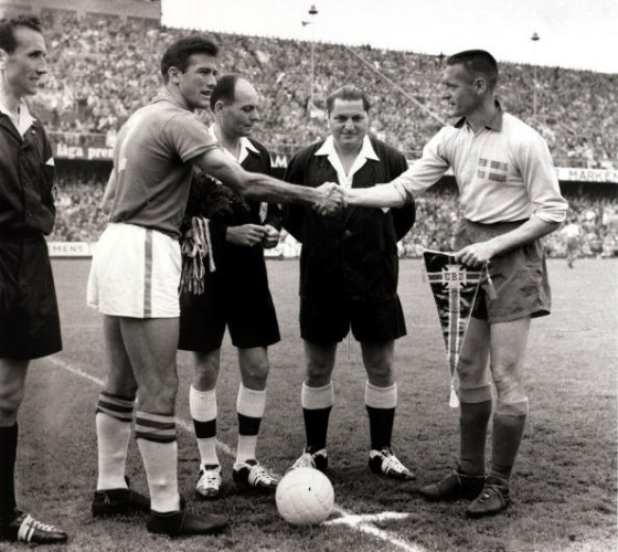 Sport/Football. 1958 World Cup Final. Stockholm. 29th June 1958. Sweden 2 v Brazil 5. The Brazil captain Bellini (left) greeted by Sweden captain Nils Liedholm before the final as the match officials look on.