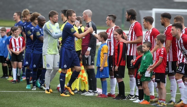 Players shake hands ahead of the game