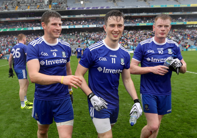 Darren Hughes, Shane Carey and Ryan McAnespie celebrate after the game