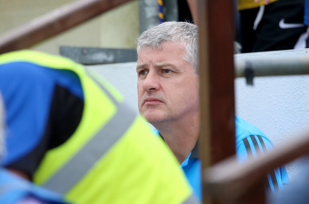 Kevin McStay watching the game away from his dugout