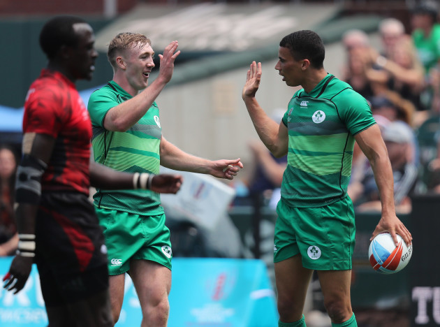 Ireland's Terry Kennedy and Jordan Conroy celebrate a  try
