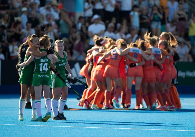 The Irish players embrace as The Netherlands team celebrates
