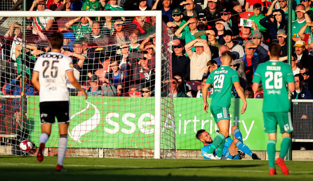 Mark McNulty is beaten by a shot from Jonathan Levi to concede a goal