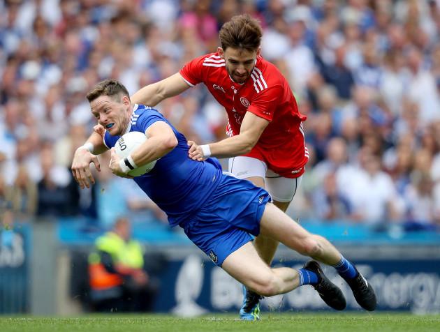 Conor McManus with Padraig Hampsey