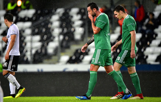 Damien Delaney and Garry Buckley dejected after their side conceded a goal
