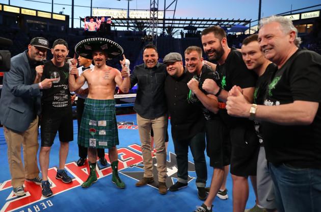 Gary O'Sullivan celebrates with trainer Paschal Collins and Oscar De La Hoya