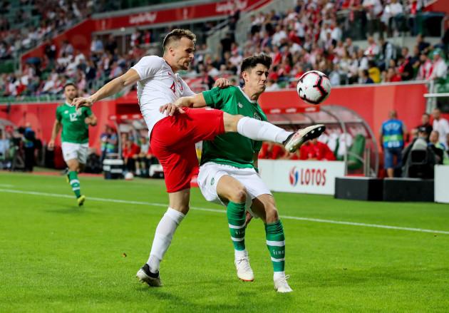 Callum O'Dowda with Tomasz Kedziora