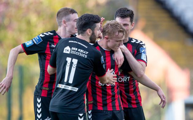 Bohemians players congratulate goal scorer JJ Lunney after scoring a goal