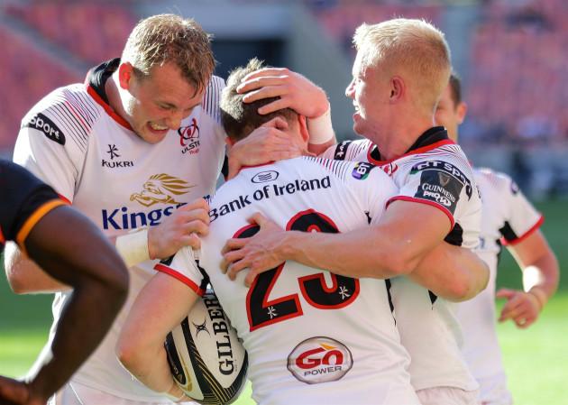 Angus Kernohan celebrates scoring a try with David Shanahan and Kieran Treadwell
