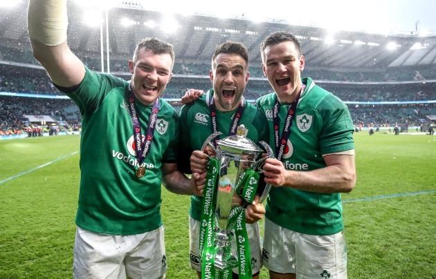 Peter O'Mahony, Conor Murray and Jonathan Sexton celebrate winning