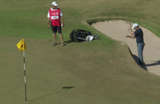 Golfer putts from bunker with the ball at waist height