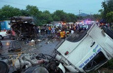 Bus and truck collide on busy Thai highway, killing 19