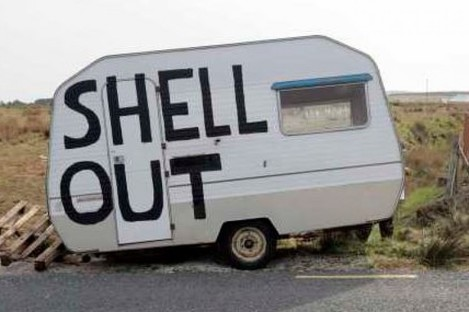 File photo of a caravan painted by campaigners from a 2011 protest