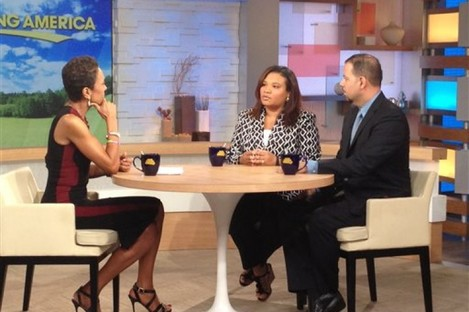 This image released by ABC shows host Robin Roberts, left, with Juror B29 from the George Zimmerman trial, center, and attorney David Chico on Good Morning America.