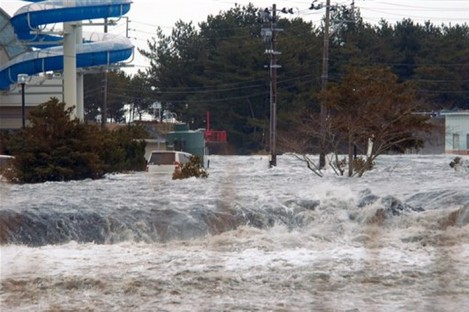 The area is flooded by tsunami in Iwaki, Fukushima Prefecture (state) as Japan was struck by a magnitude 8.9 earthquake off its northeastern coast Friday, March 11, 2011.