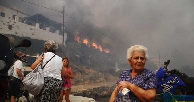Villages evacuated as wildfires rage on Greek islands