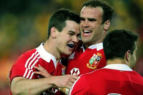 Jonathan Sexton celebrates with Jamie Roberts.