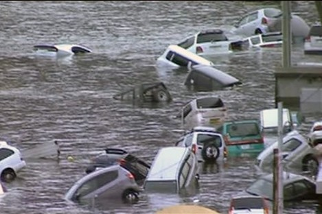 In this image made off Japan's NHK TV video footage, vehicles are washed away by tsunami in coastal area in eastern Japan after Japan was struck by a magnitude 8.9 earthquake off its northeastern coast Friday, March 11, 2011.