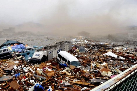 A huge tidal wave washes away houses and cars at Kesennuma port on Friday, in Miyagai Prefecture, March 11, 2011.