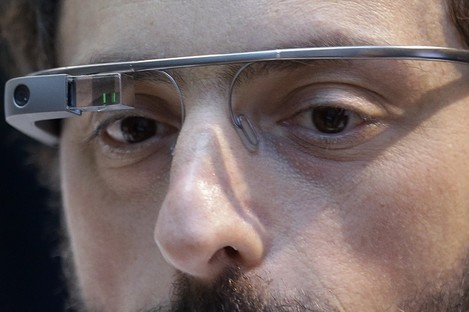 Google co-founder Sergey Brin wears a Google Glass device