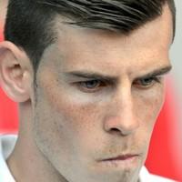 Bale bids teammates emotional goodbye as Real deal looms