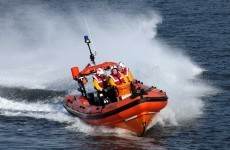 "Two ""shocked and traumatised"" men rescued after boat capsizes"