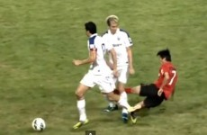 Chinese player's crazy two-footed lunge... on the wrong player