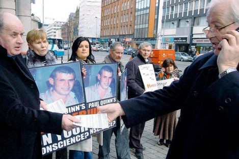 The Quinn family and supporters handing out information at a picket in Belfast in 2010