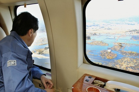 Japanese prime minister Naoto Kan surveys the damage in the Fukushima prefecture earlier today.