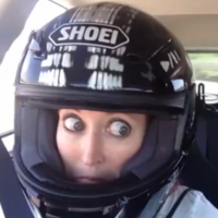 Scared woman in rally car does CRAZY EYES