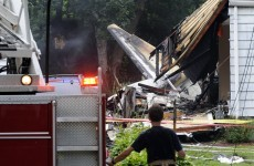 Pics: Plane crashes into houses, four found dead