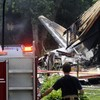 Pics: Plane crashes into houses, four found dead