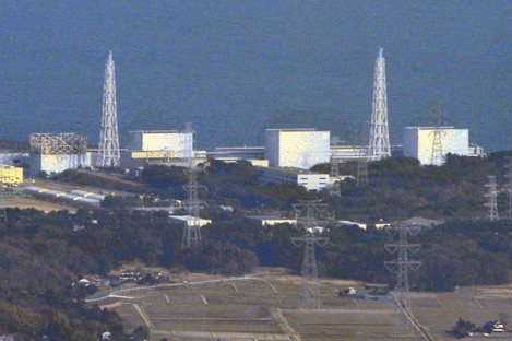 The nuclear plant at Fukushima, pictured yesterday, with the damaged containment building at reactor 1 on the left. The nuclear cores at all three reactors are now thought to be melting.