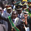 """Mugabe tells defeated foe to """"go hang"""""""