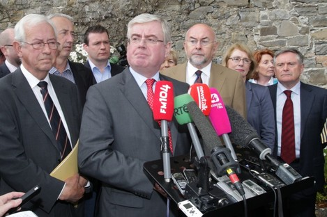 Emmet Stagg (left) with Tánaiste Eamon Gilmore and other senior members of the Labour Party