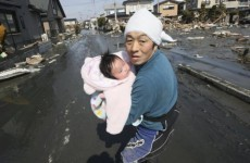 Survivors pulled from wreckage of Japan's earthquake and tsunami