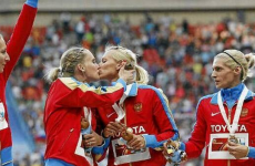 Russian sprinters appear to protest 'anti gay' law with podium kiss