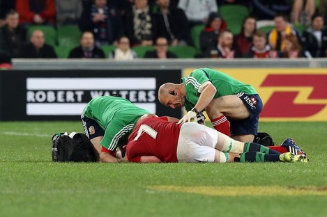 Dr Eanna Falvey and Physio Phil Pask treat Sean O'Brien on the 2013 Lions Tour.