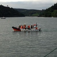 Three rescued from boat that could have hit rocks