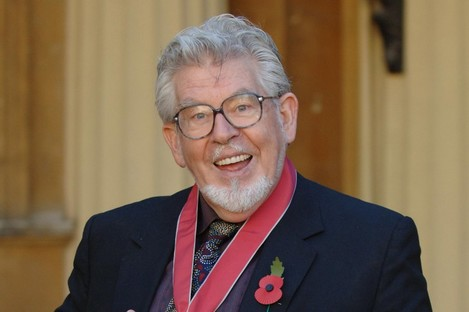 Rolf Harris with his CBE medal in 2006.