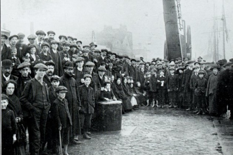 Workers waiting on the docks for the food ships coming from the UK