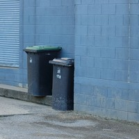 Four arrested after man found beaten and naked in a wheelie bin