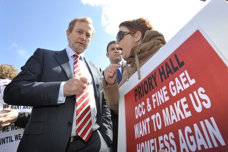 Enda Kenny speaks to former resident Stephanie Meehan at a protest last year.
